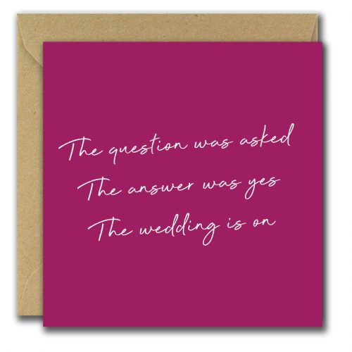 congratulations on engagement greeting card with dark pink background and text